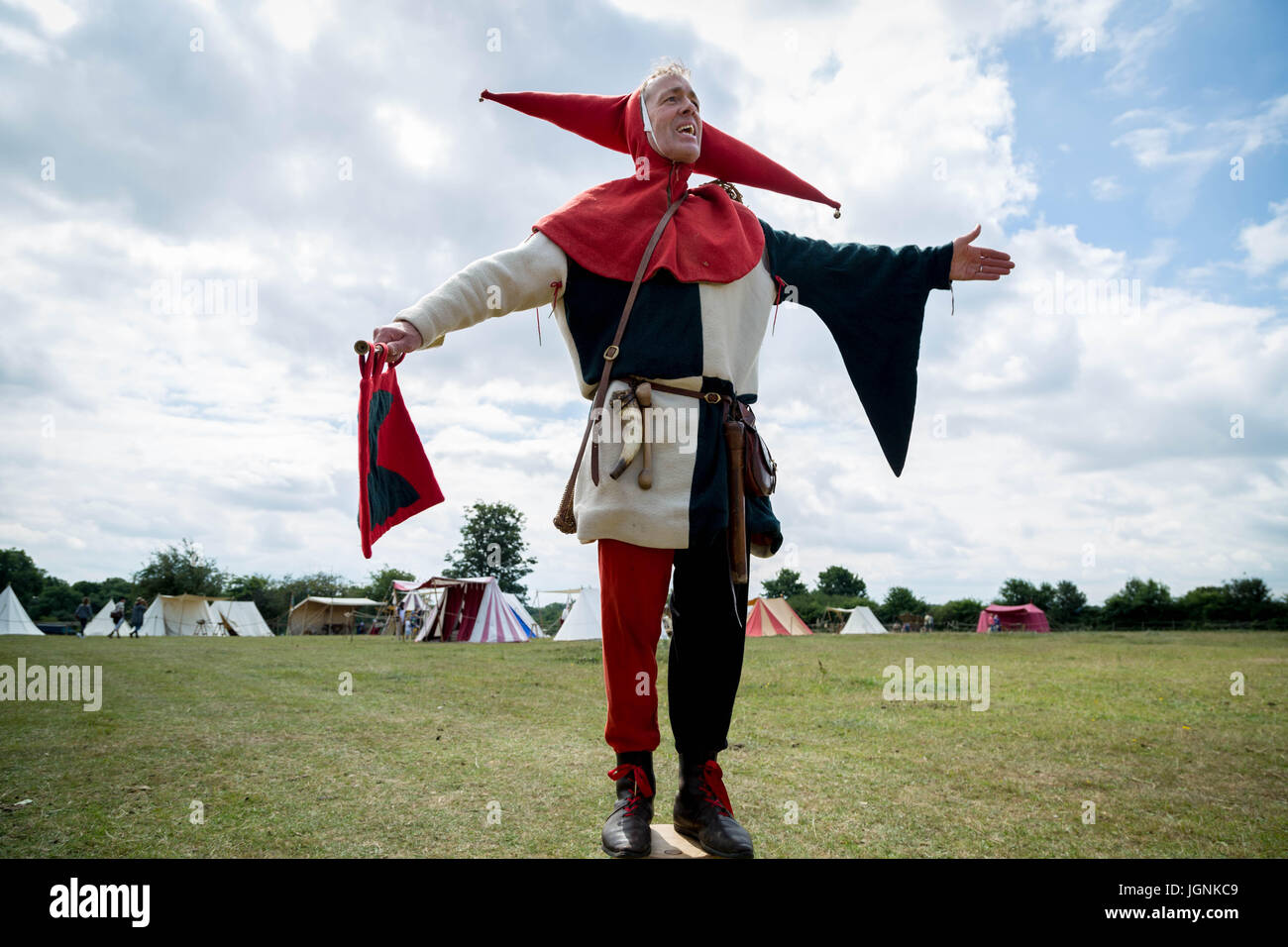 London, Eltham, UK. 8th July, 2017. Peterkin the Fool Jester performs at the Grand Medieval Joust, Eltham Palace. - Stock Image