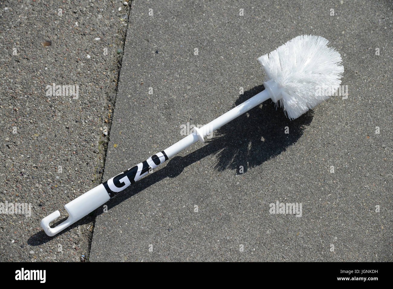 Hamburg, Germany. 8th Jul, 2017. Protest rally on St. Pauli against G-20 summit in July 2017, toilet brush used - Stock Image