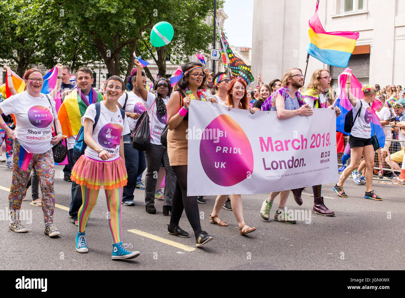 London, UK. 8th July, 2017. Bi Pride UK at London pride 2017. Thousand of people join the annual LGBT  parade through - Stock Image