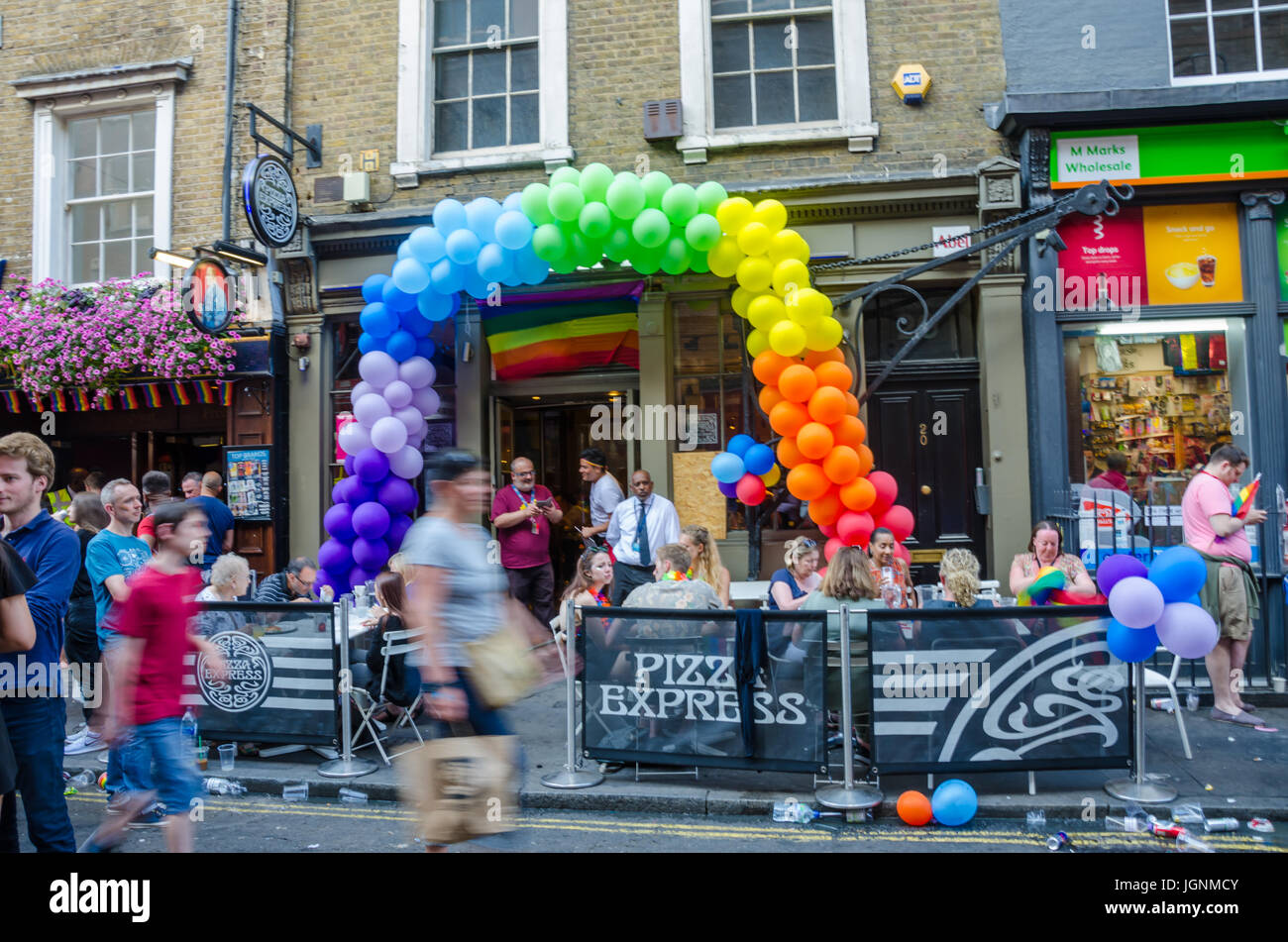 Pizza Express on Wardour Street in Soho, London has a colourful balloon arch as part of London Pride celebrations. - Stock Image