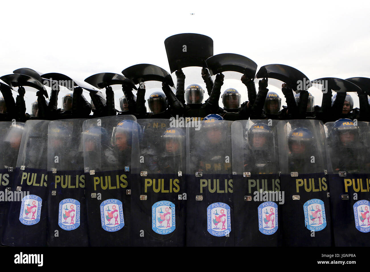 Beijing, China. 8th July, 2017. Policemen carrying shields stand in formation during the annual Philippine National - Stock Image