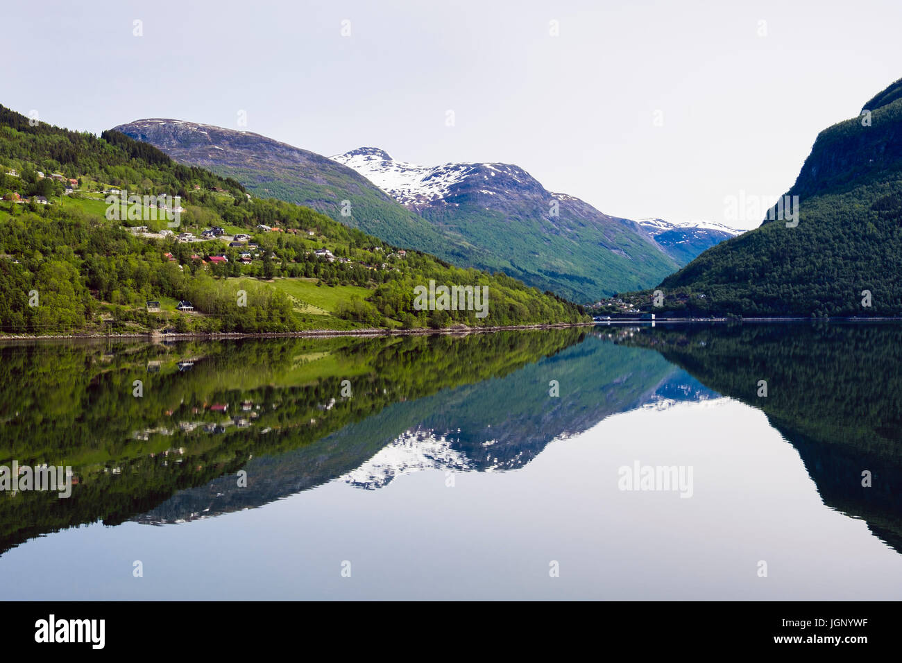 Reflections in calm waters of Nordfjorden Fjord on Norwegian west coast near Olden, Sogn og Fjordane county, Norway, Stock Photo
