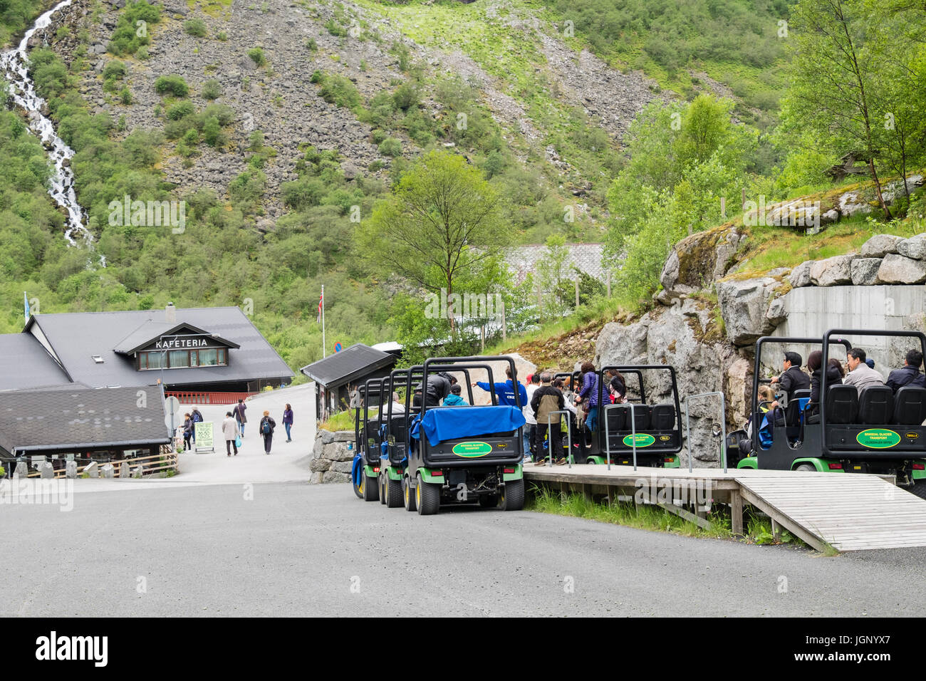 Troll cars transport vehicles for taking tourists to Briksdalsbreen or Briksdal glacier in Briksdalen or Briks valley - Stock Image