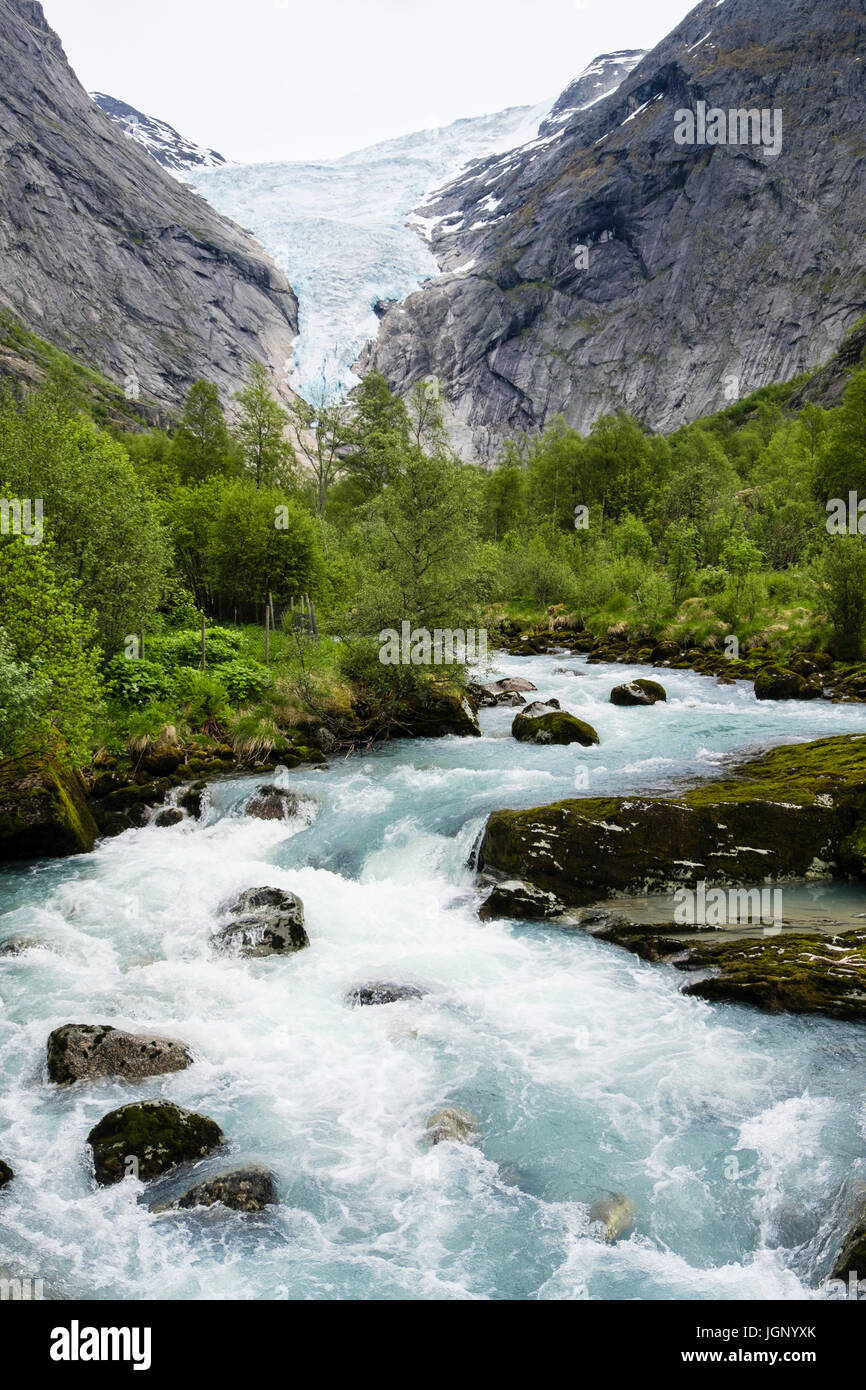 View along river to Briksdalsbreen or Briksdal glacier arm of Jostedalsbreen glacier in Briksdalen in Jostedalsbreen Stock Photo