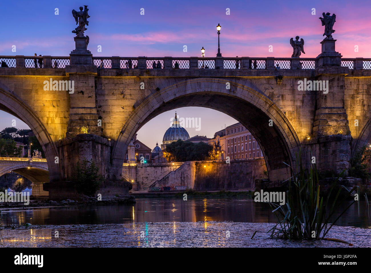 Saint Peter's Basilica with Sant'Angelo's bridge over Tiber at sunset, Rome, Italy - Stock Image
