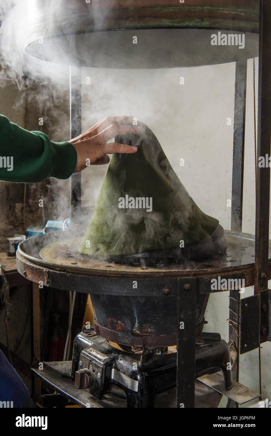 Hand Taking Hat Bodies Out Of Steam Boiler Hatmaker Workshop Bad