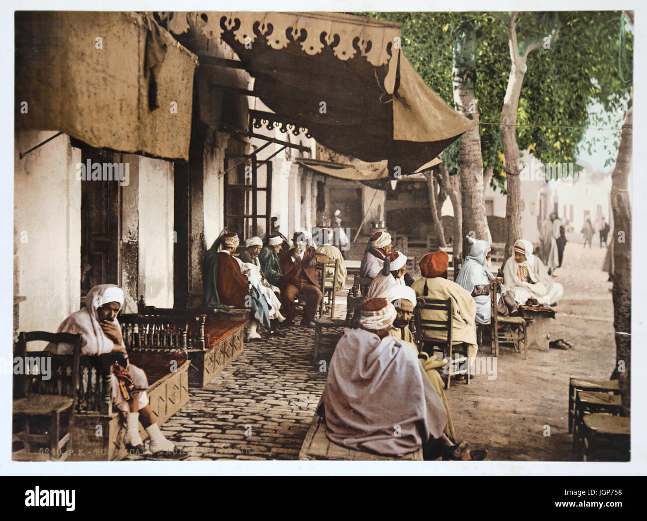 View of terrace of a moorish cafe in Tunis. Usual customers in 1899. Photochrome print. Part of a colour photo album. - Stock Image