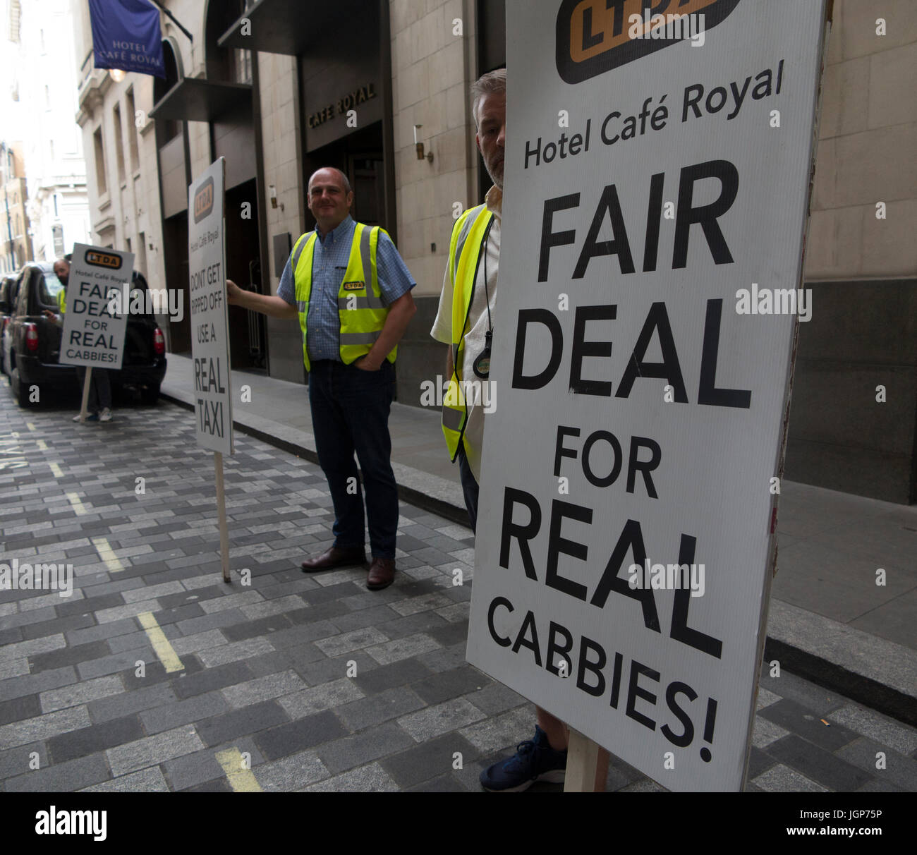 Cabbies protest outside the Cafe Royal Hotel wanting a fairer deal Stock Photo