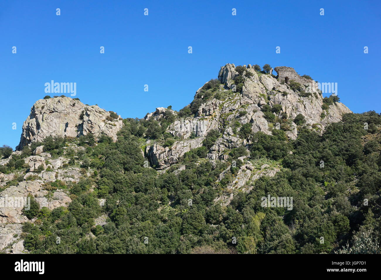The ruins of the castle of Ultrera at the top of a steep rocky spur of the Massif des Alberes, Pyrenees Orientales, - Stock Image