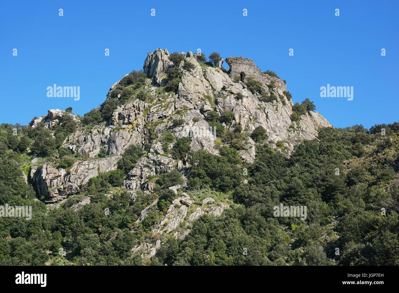 The ruins of the castle of Ultrera located at the top of a steep rocky spur of the Massif des Alberes, Pyrenees - Stock Image
