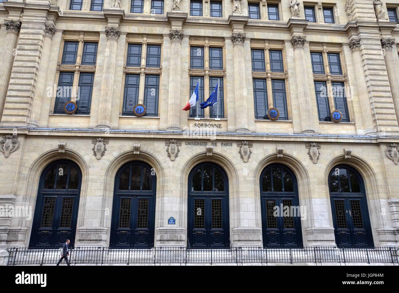 PARIS - AUG 11:  A man walks past Paris-Sorbonne University in Paris, France on August 11, 2016. It is one of the - Stock Image