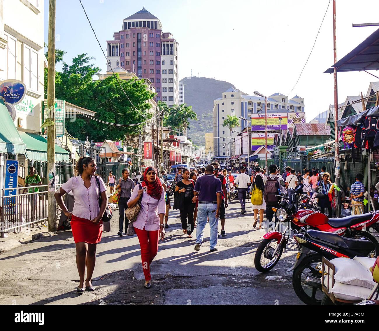 Port Louis, Mauritius - Jan 4, 2017. People walking on street in Port Louis, Mauritius. Port Louis is the business Stock Photo