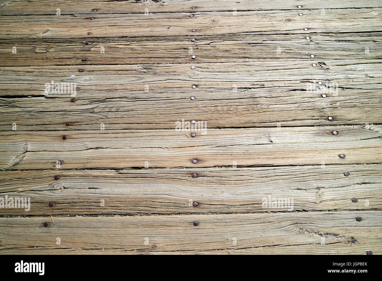 worn wooden planks on boardway harborwalk Boston USA - Stock Image