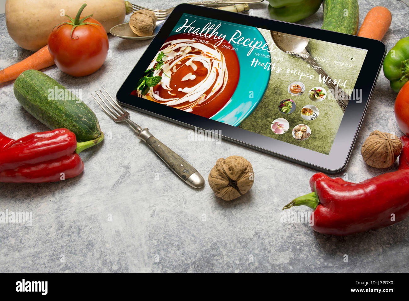 Tablet with healthy recipes blog on screen web with nutritious food tablet with healthy recipes blog on screen web with nutritious food on grunge background forumfinder Choice Image