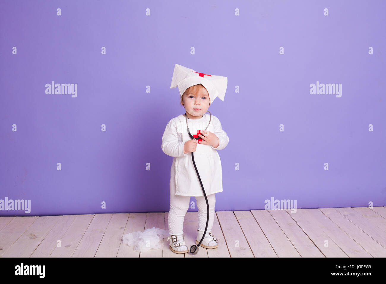 little girl plays in the hospital nurse - Stock Image