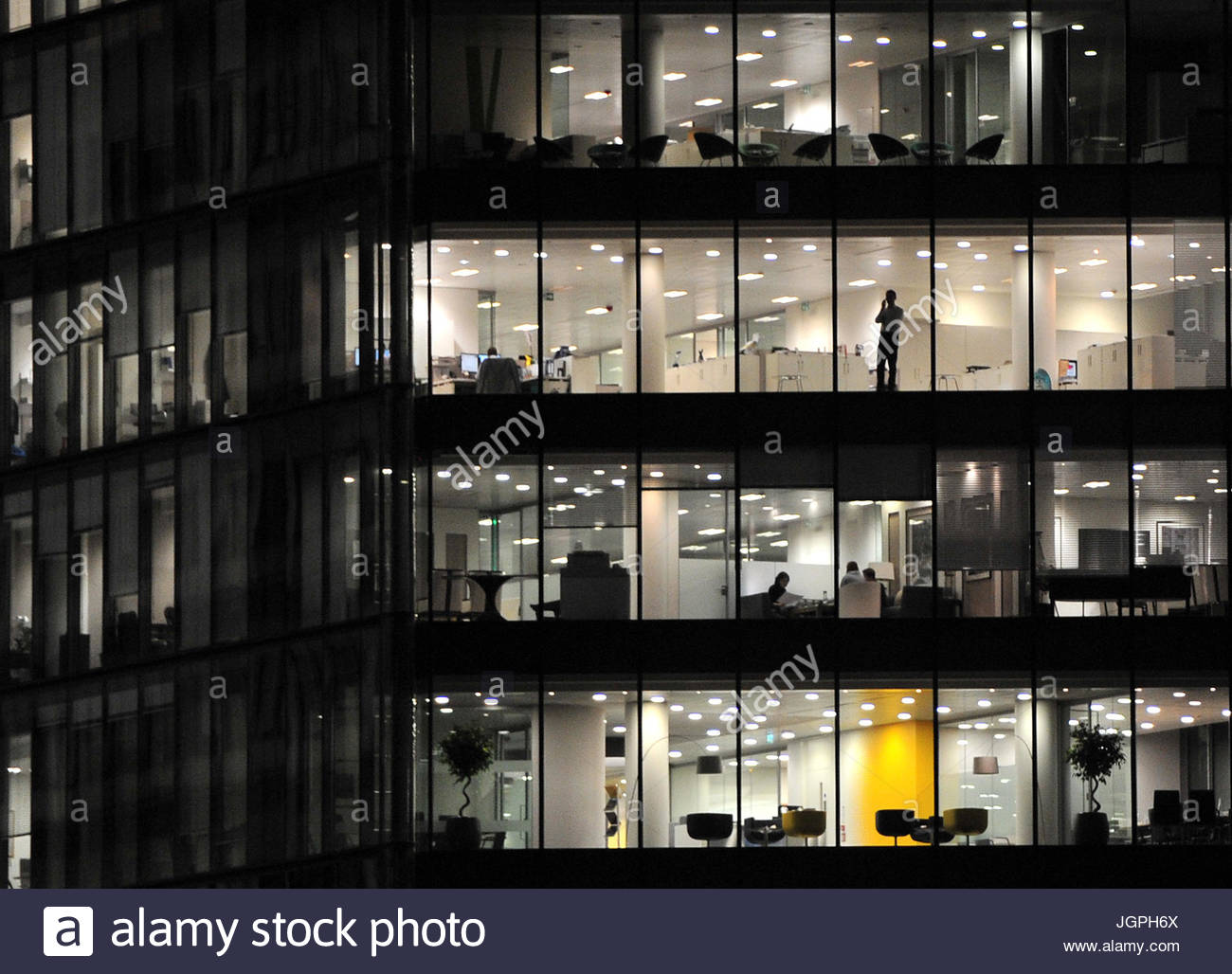 File photo dated 19/11/14 of an office worker in central London. Most firms expect to increase the number of highly Stock Photo