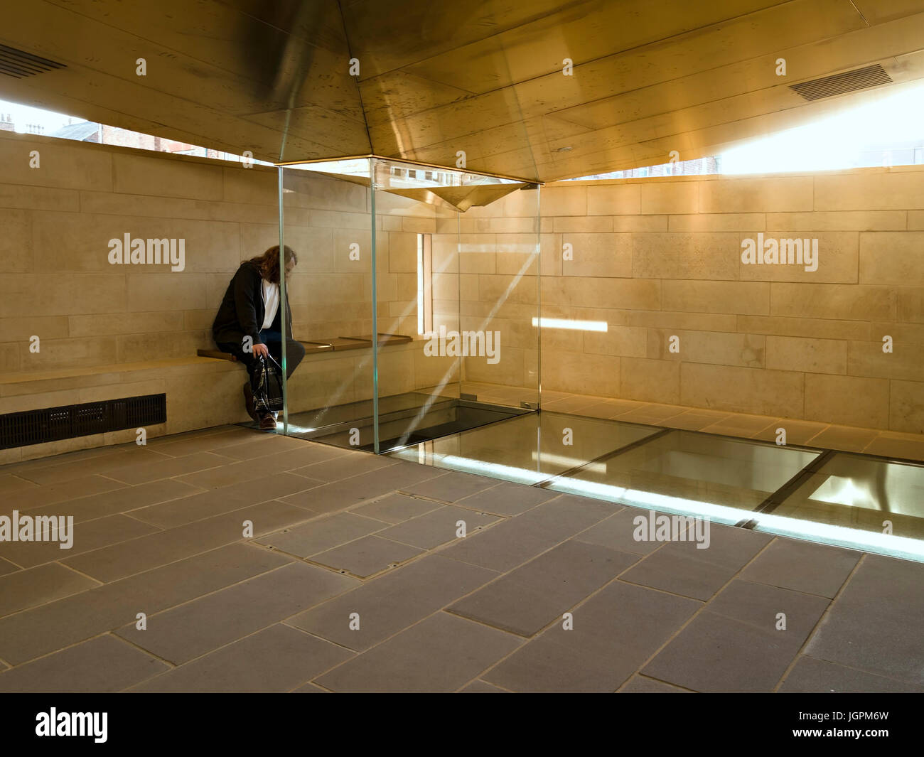 Visitor viewing original grave site of King Richard III in the King Richard III Visitor Centre Exhibition, Leicester, - Stock Image