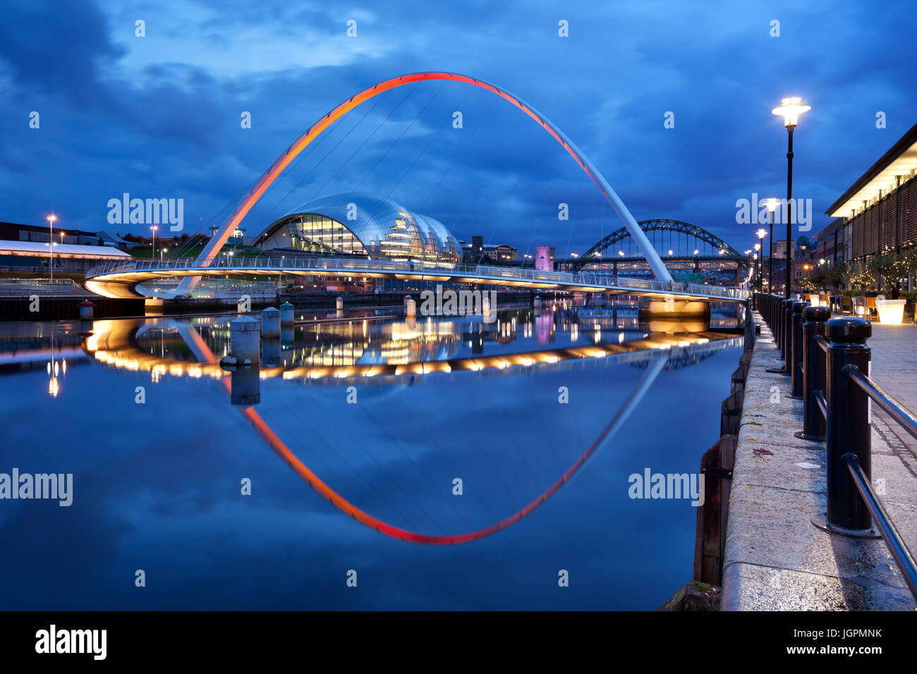 The Gateshead Millennium Bridge over the river Tyne in Newcastle upon Tyne, England. Stock Photo