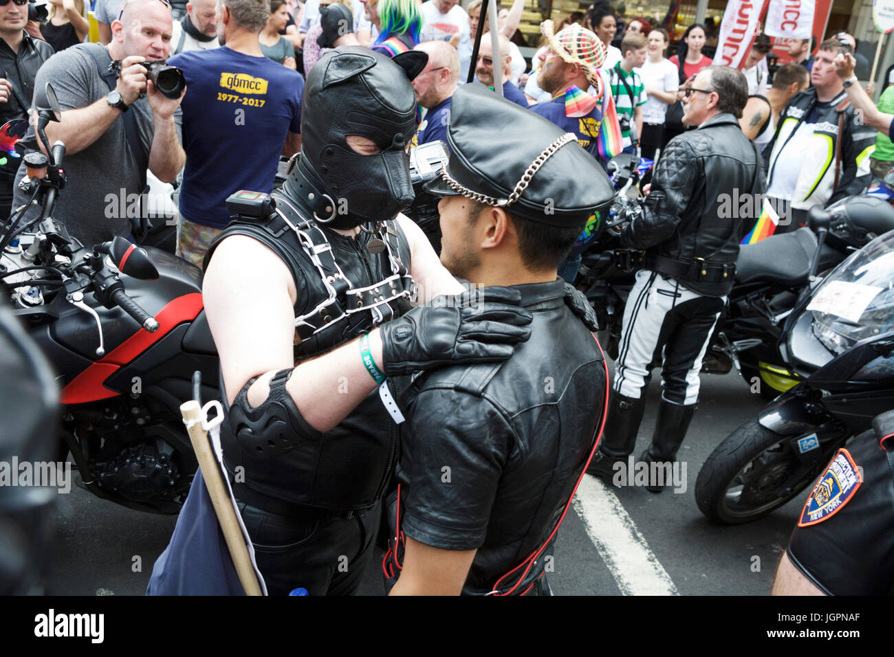 A Soho street scene London. Gay men in leather enjoying the Soho street party atmosphere, after Gay Pride, the annual - Stock Image