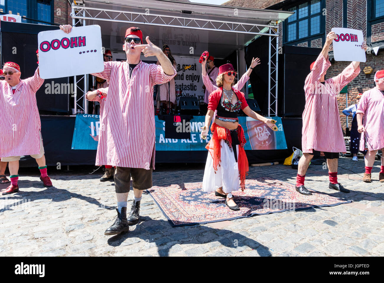 Fabulous Fezheads musical group perform gig at the Ken coastal town of Sandwich during the Folk and Ale festival. - Stock Image