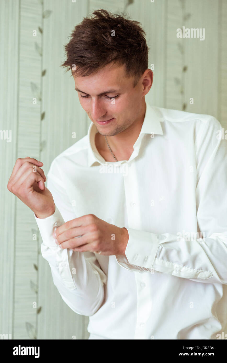 Man fastening a cuff - Stock Image