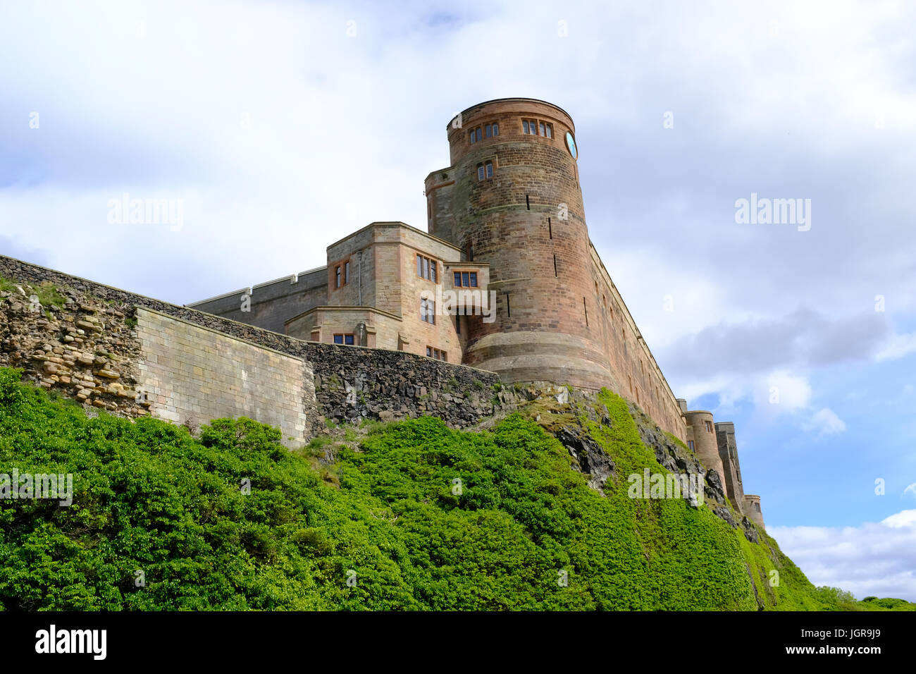 Bamburgh Castle - located on the northeast coast of England in Northumberland in the UK - Stock Image