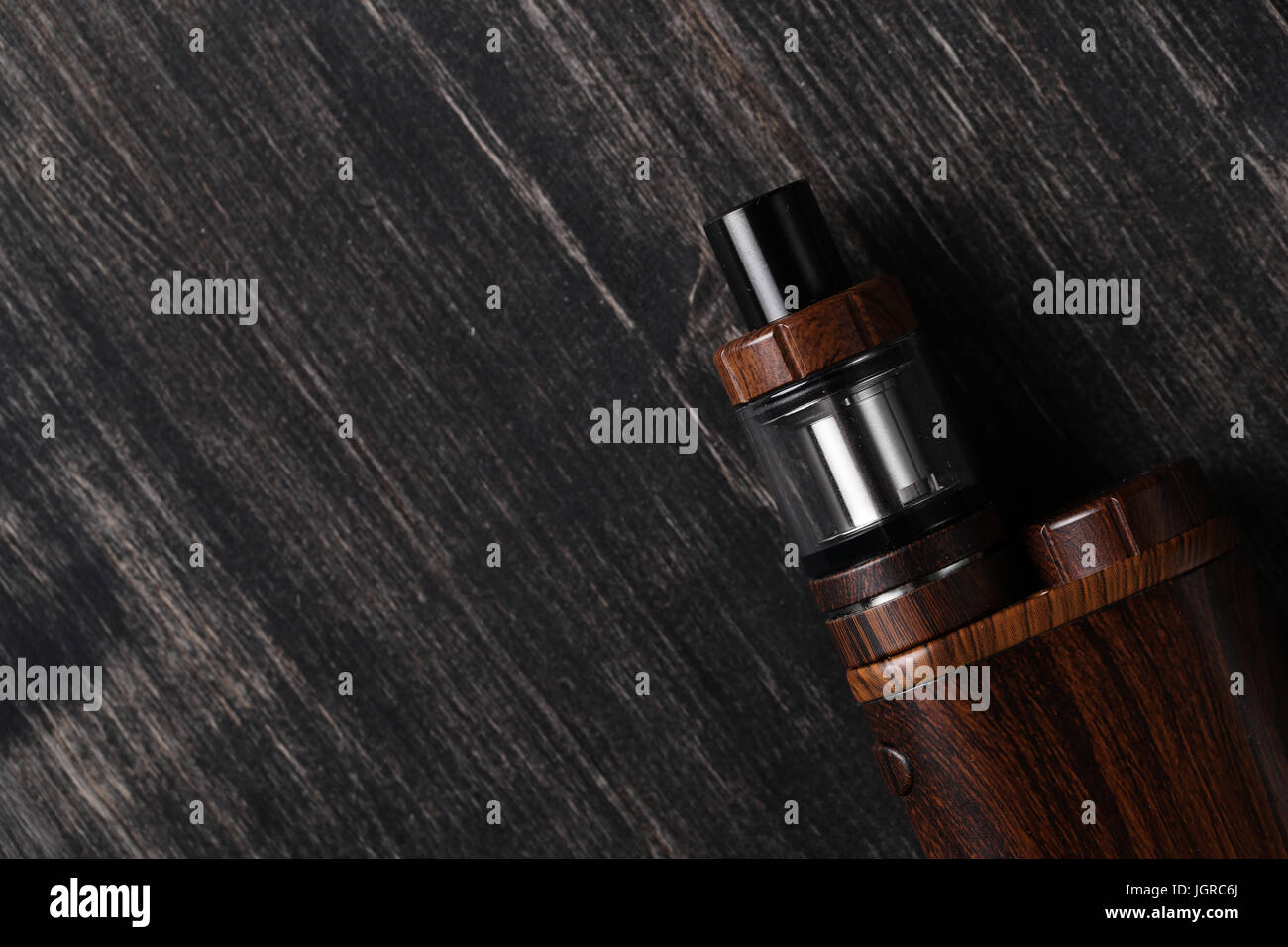 Vaping device on the wooden table - Stock Image
