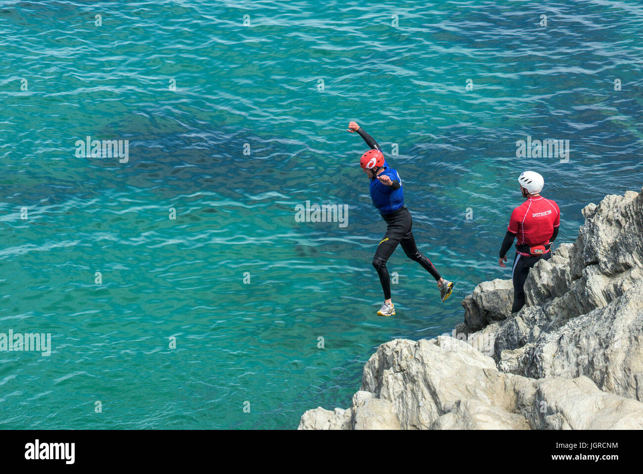 Coasteering on The Headland in Newquay, Cornwall. - Stock Image
