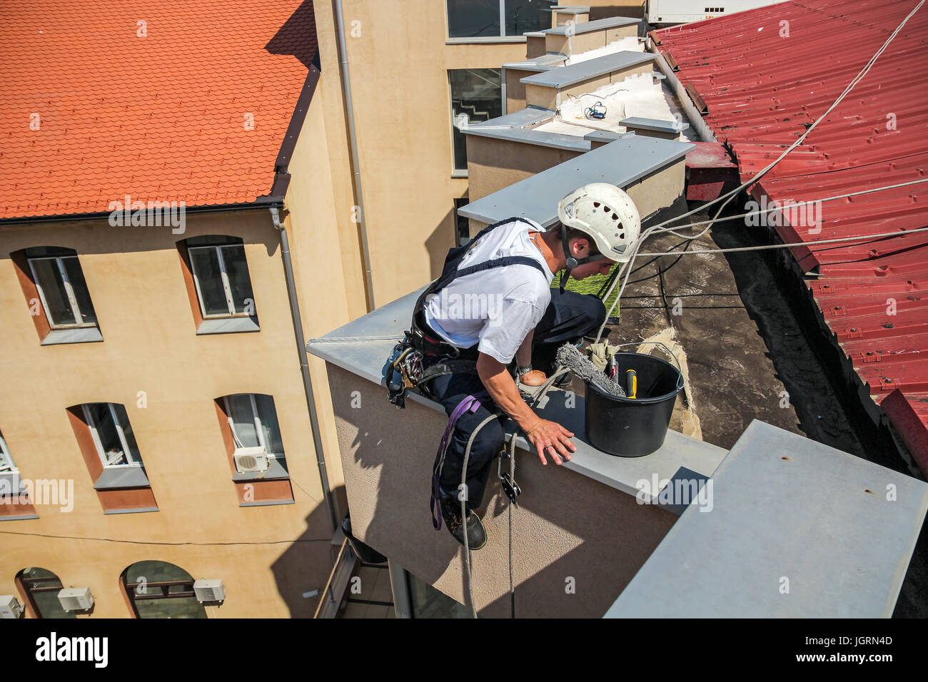 Industrial climbing - Facade Cleaning Service.  High Risk Work - Stock Image