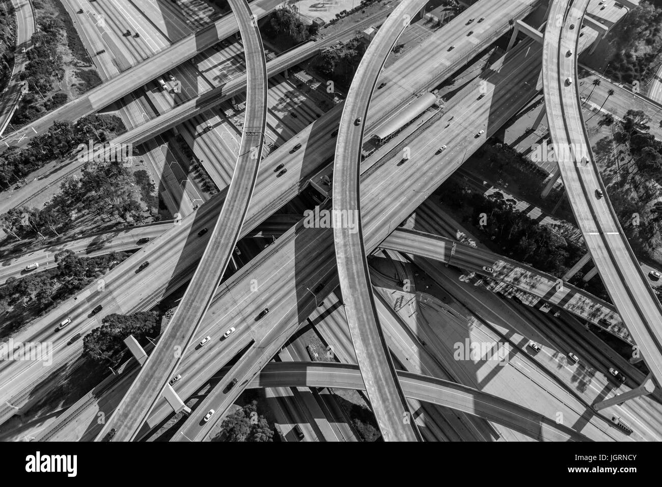 Harbor 110 and Century 105 freeway interchange aerial south of downtown Los Angeles in black and white. - Stock Image