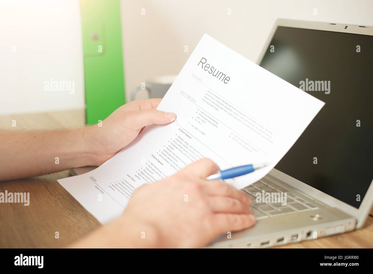 Man looking for a job and filling the worker resume - Stock Image