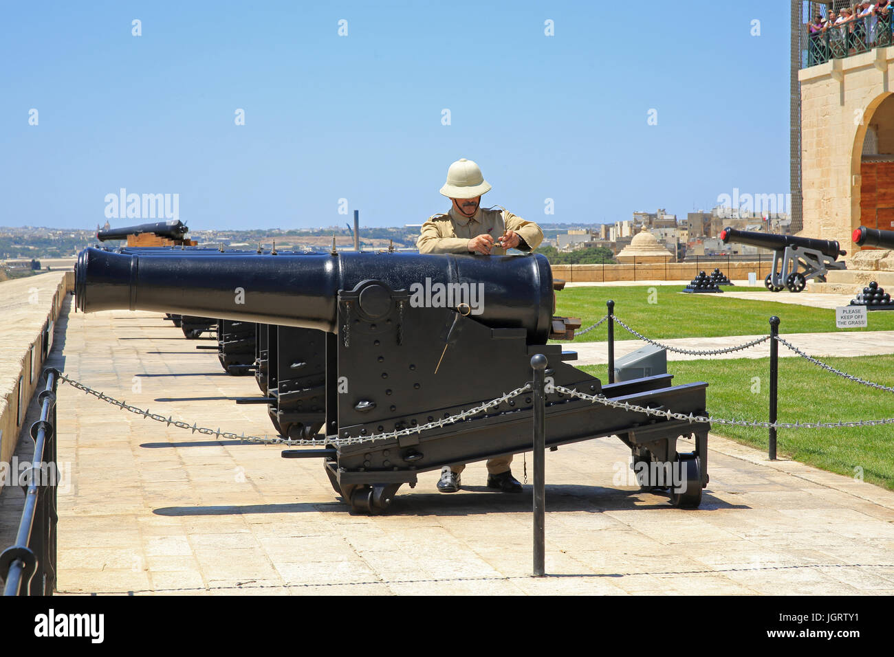 The daily midday Saluting Battery, below Upper Barracca Gardens, in Valletta, Malta - Stock Image
