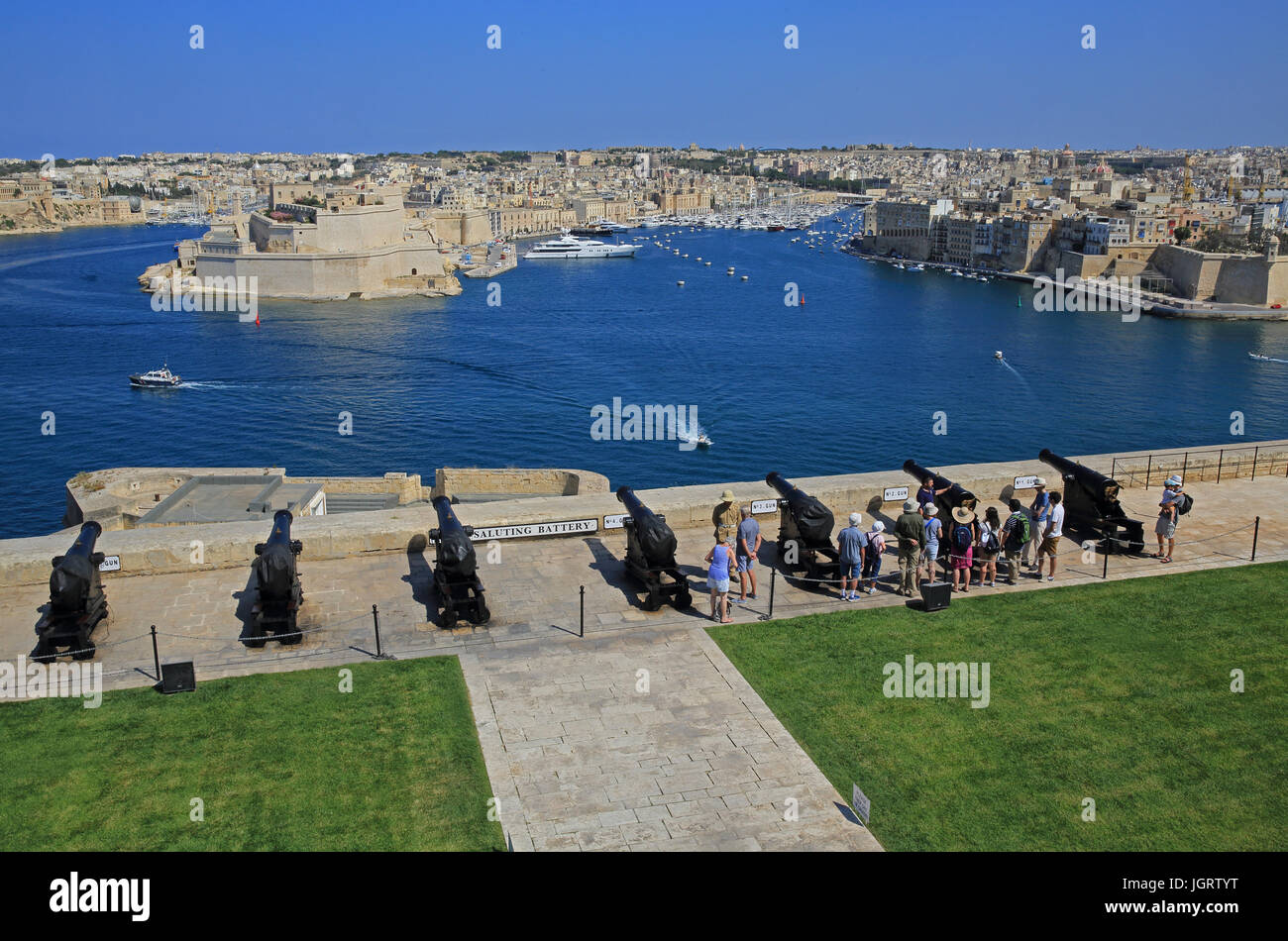 The Saluting Battery, with the Three Cities beyond, in Valletta, Malta - Stock Image