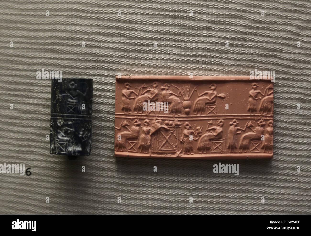 Lapis lazuli cylinder seal by Queen Paubi. Banquet scenes. Ur. 2600 BC. British Museum. London. UK. - Stock Image