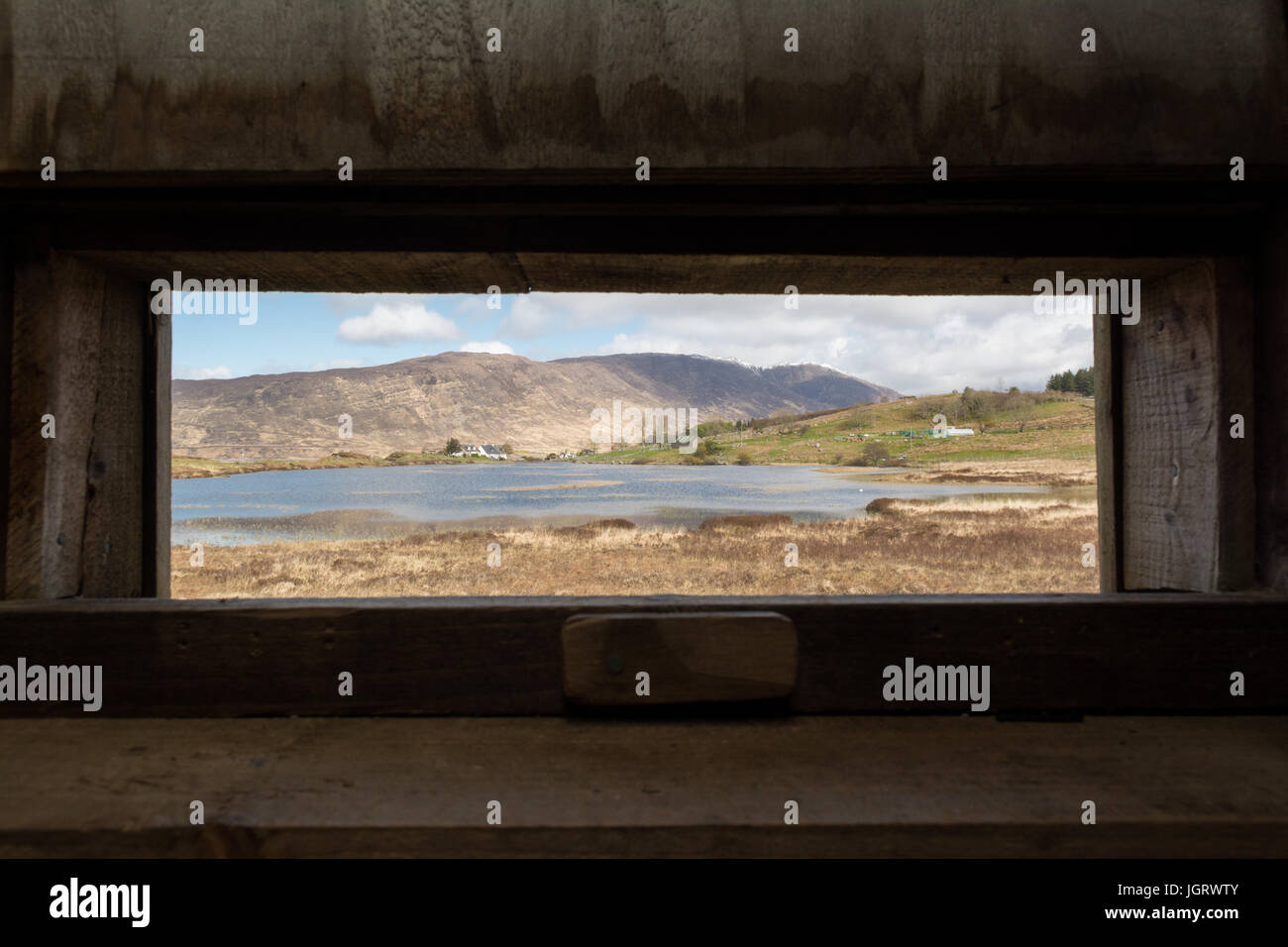 Milltown Loch, Applecross, Scotland - view from inside the nature hide - Stock Image