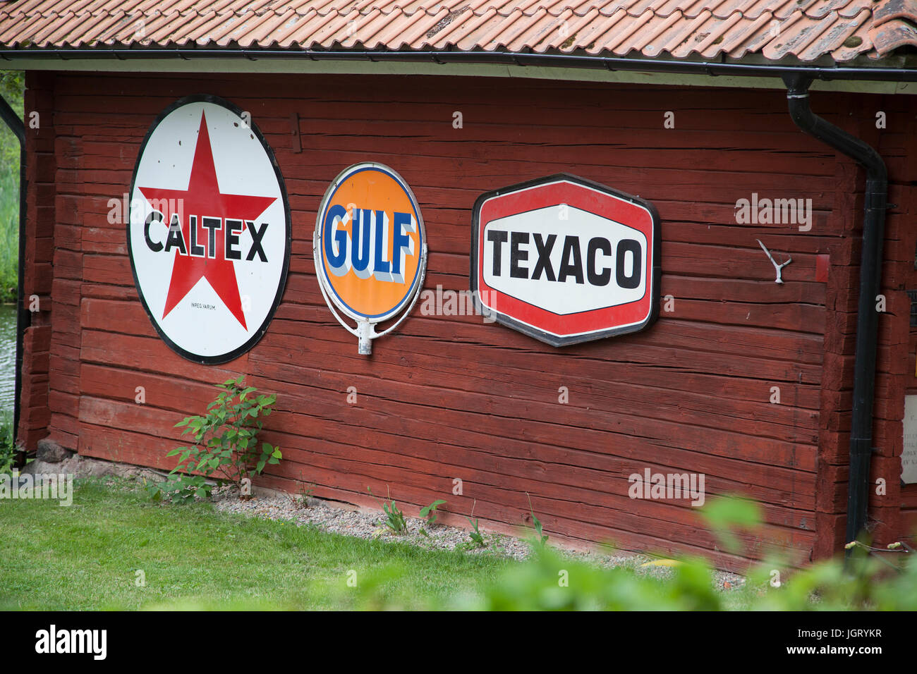ENAMEL SIGNS for international gasoline companies -on a cottage wall -no longer active in Sweden -2017 - Stock Image