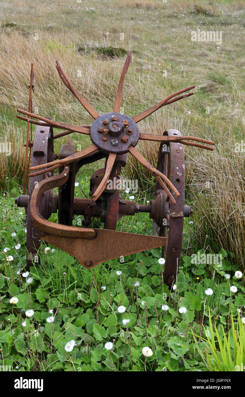 old farm machinery on grazing land;caithness;scotland - Stock Image