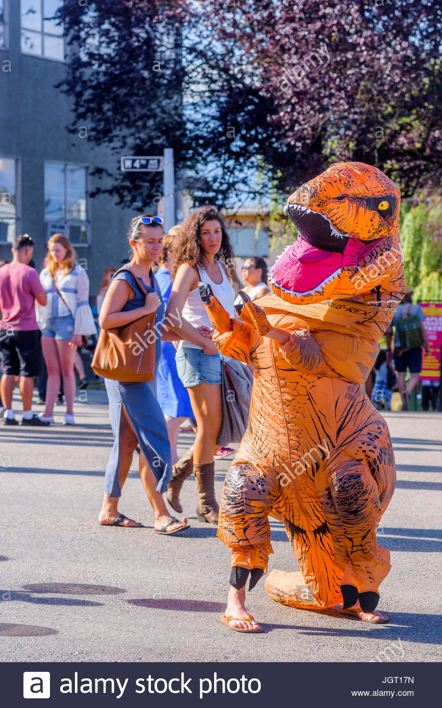 Stomping out plastic pollution. Plastic awareness dinosaur at Khatsalano Festival, Kitsilano, Vancouver, British - Stock Image