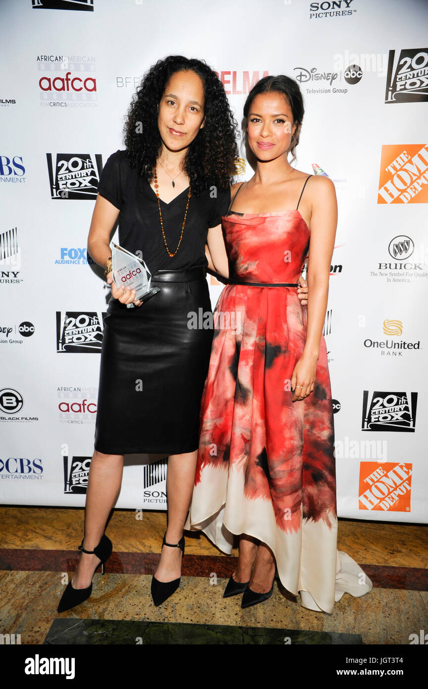 (L-R) Film director screenwriter Gina Pince-Bythewood actor Gugu Mbatha-Raw attends 6th Annual AAFCA Awards Taglyan Stock Photo