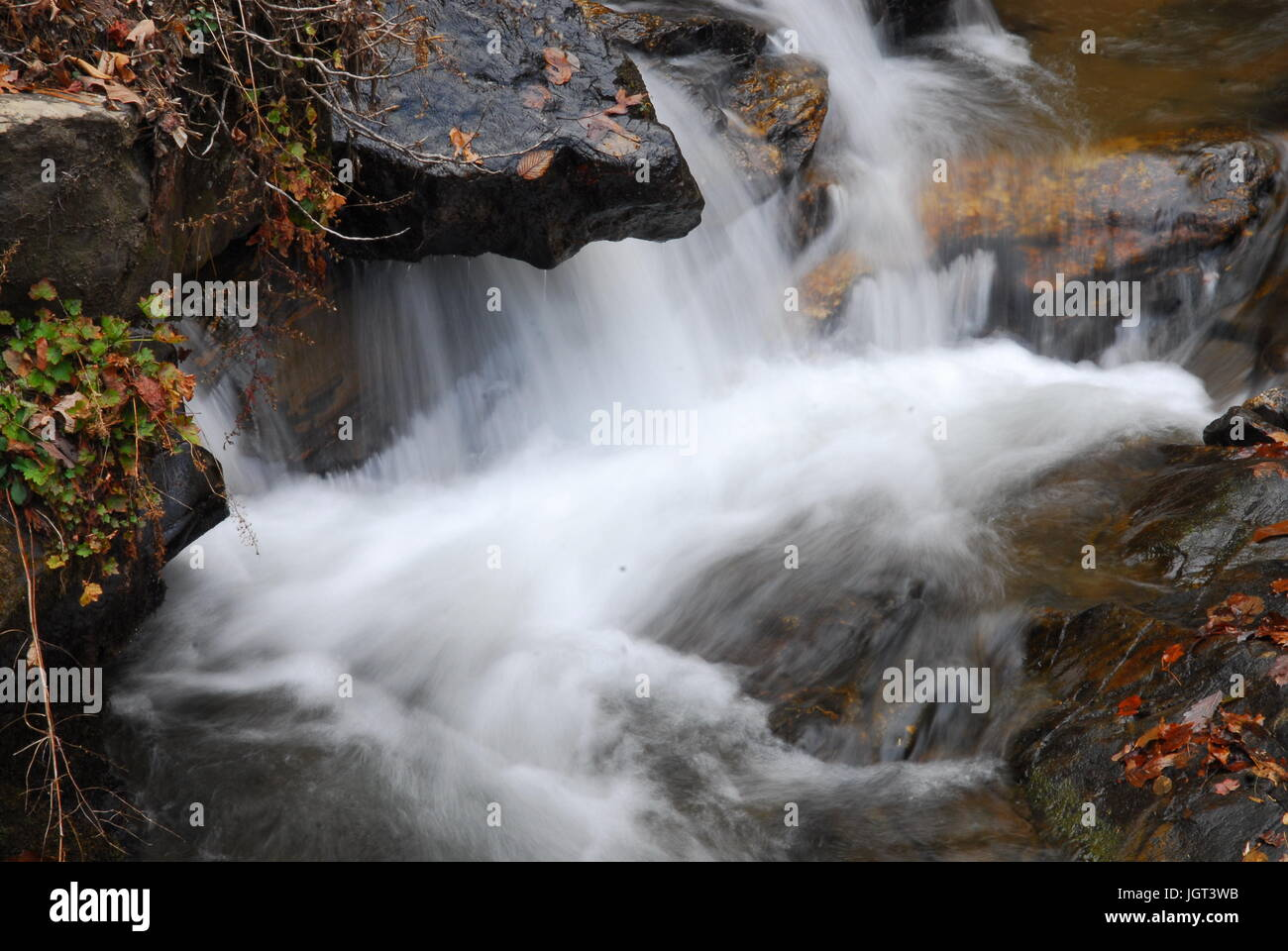 water flowing thru rocks in the mountains - Stock Image