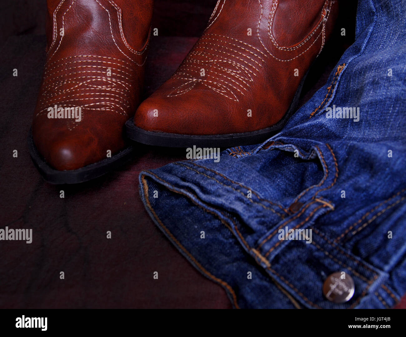 Western look, blue jeans and cowboy boots. - Stock Image