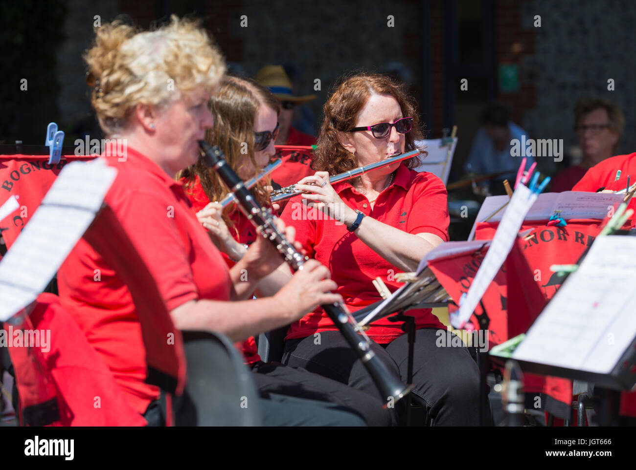 Woman playing a flute with the Bognor Regis Concert Band at a Summer charity event. Female flautist. - Stock Image
