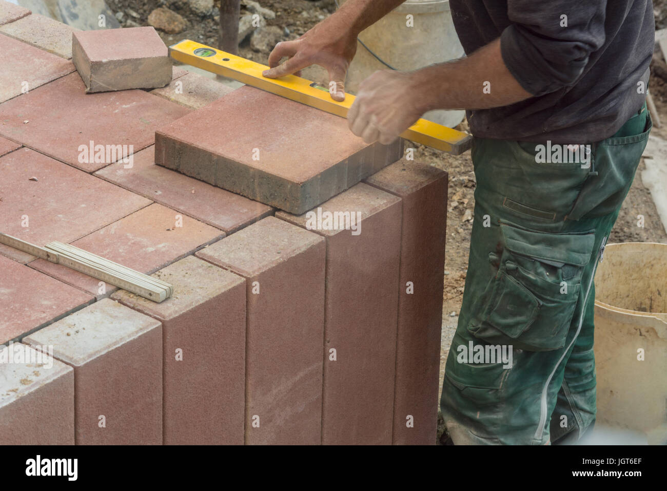 Man cutting stone slabs, concrete slab with an electric grinder Stock Photo