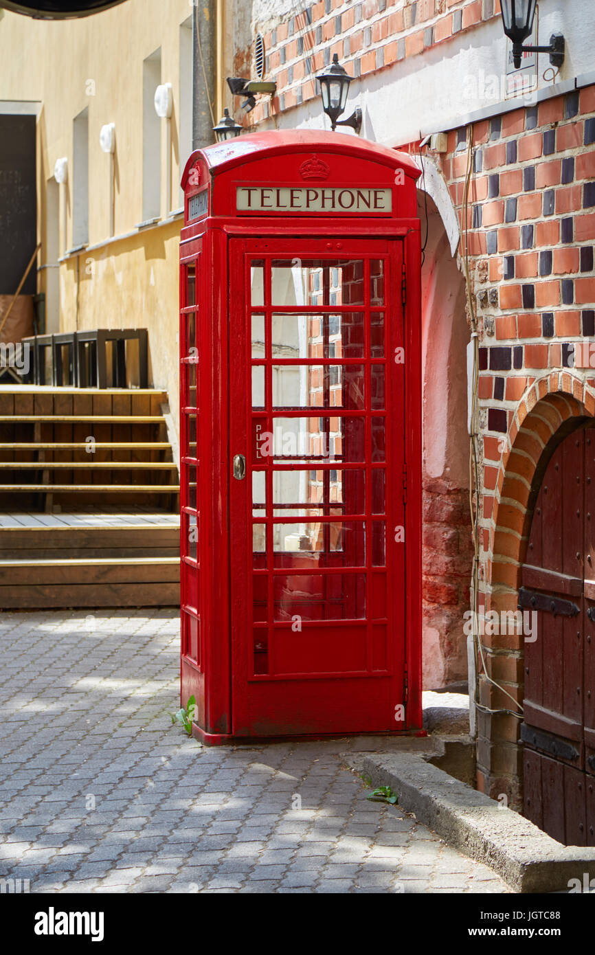 The red british telephone booth is on the street - Stock Image