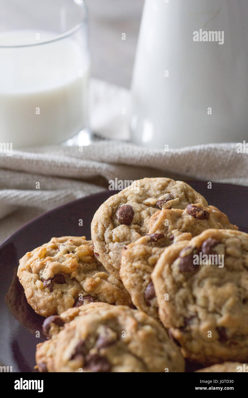 Cookies and a glass of milk on canvas towel - Stock Image