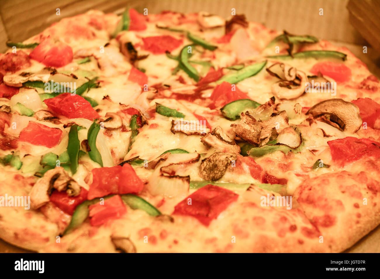 Vegetable Pizza For Dinner At Italian Restaurant Close Up