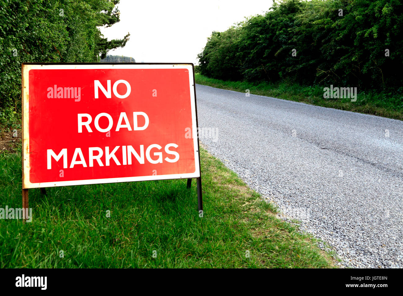 No Road Markings, sign, new road surface, English traffic warning signs, England, UK - Stock Image