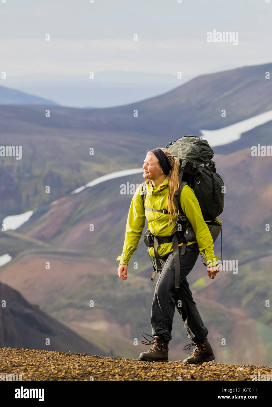 Young woman hiking in Iceland Stock Photo