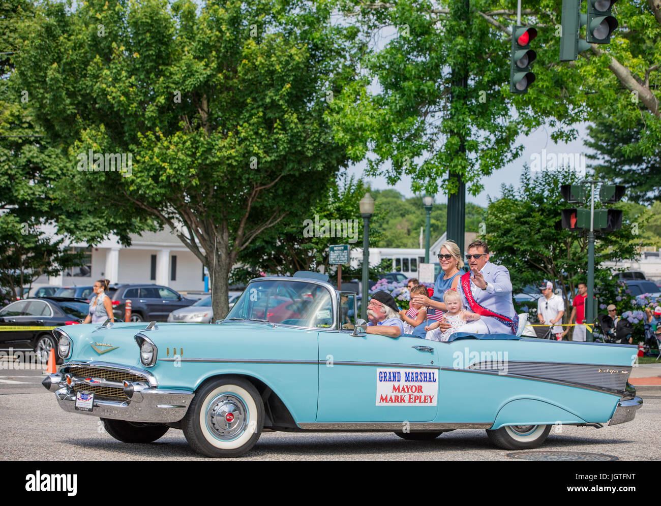 grand marshall, Mayor Mark Epley riding in the back of a 1950s era chevy in the fourth of july parade in southampton, - Stock Image