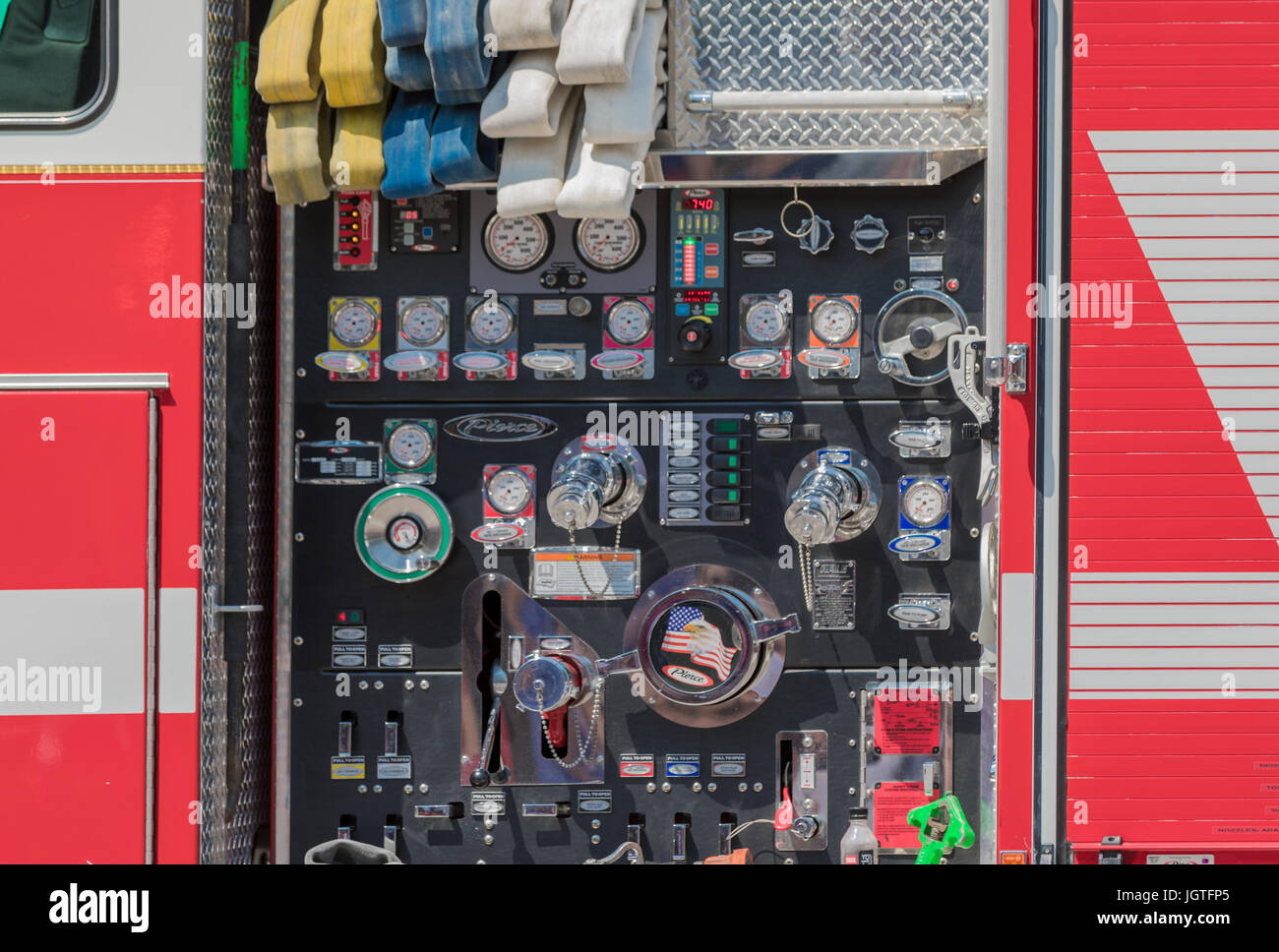 detail of the gauges and dials on a large fire truck - Stock Image